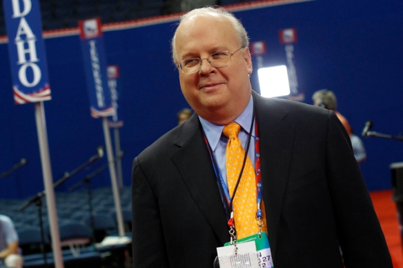 Republican political strategist Karl Rove walks the floor of the Republican National Convention in Tampa